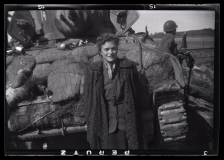 Gina Rapaport (later Leitersdorf) stands next to an American tank shortly after her liberation. She had survived the Warsaw ghetto prior to her incarceration in Bergen-Belsen. Fluent in several languages, she translated for the Americans and other survivors of the train.